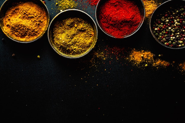 Colorful spices on dark surface Premium Photo