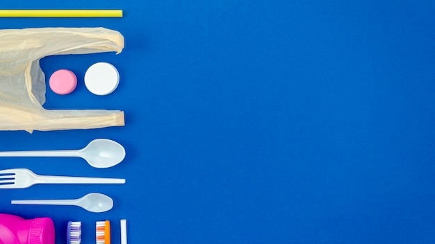 Colorful spoons on blue background Free Photo