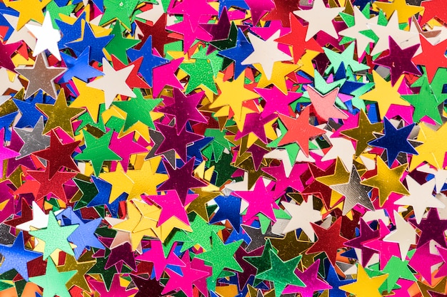 Colorful star sequin glitter textured background abstract Premium Photo