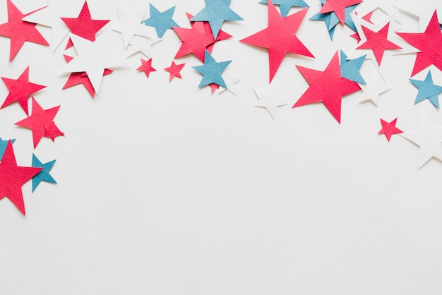 Colorful stars on white background Free Photo