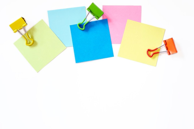 Colorful sticky note and paper clip on white background, top view  and copy space. Premium Photo