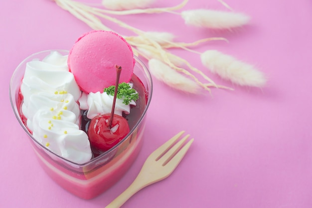 Colorful strawberry cake and macaron on pink background Free Photo