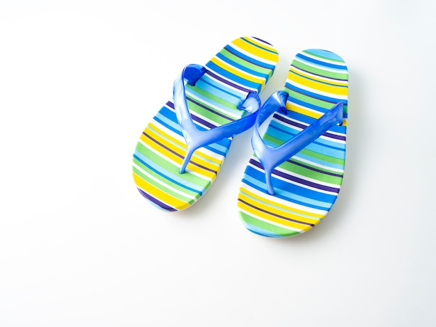 Colorful striped flip flops on white background Premium Photo