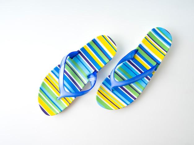 Colorful striped flip flops on white background Premium Photo