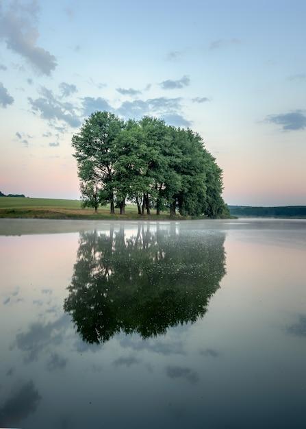 Colorful sunrise on a small lake near the village Premium Photo