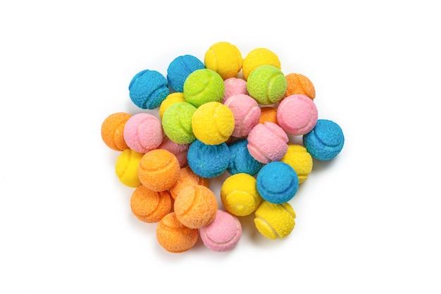 Цветастые теннисные мячи изолированные на белизне. Premium Фотографии