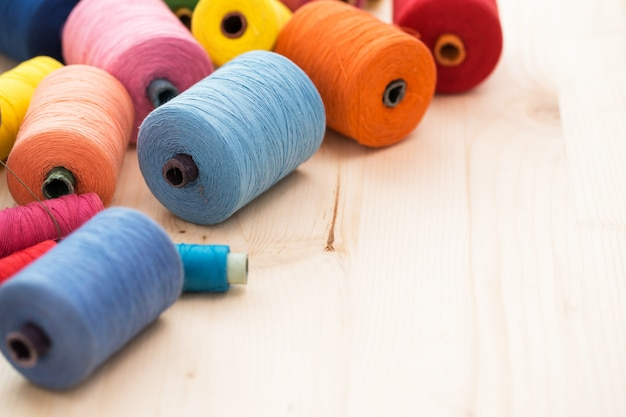 Colorful threads on the table Free Photo