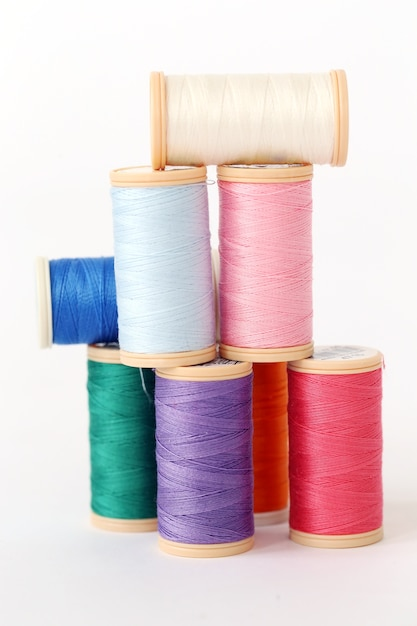 Colorful threads on a white surface Free Photo