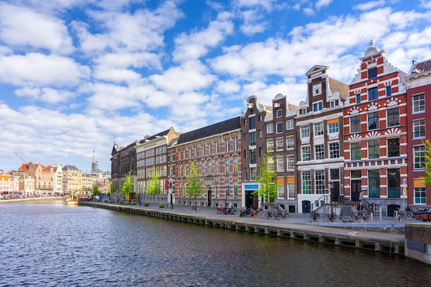 Colorful traditional old buildings in sunshine day at amsterdam, netherlands Premium Photo