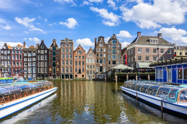 Colorful traditional old buildings in sunshine day at amsterdam Premium Photo