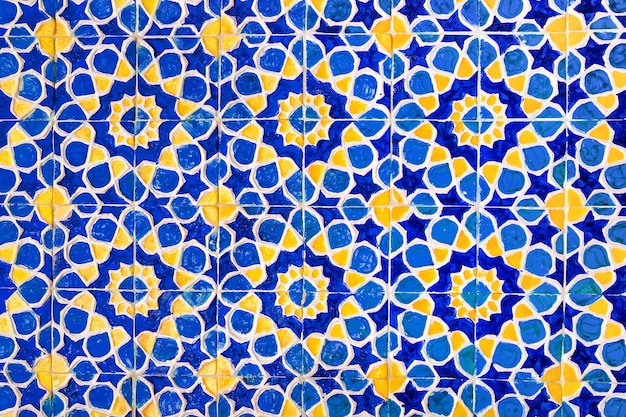 Colorful traditional uzbek pattern on the ceramic tile on the wall of the mosque, background Premium Photo