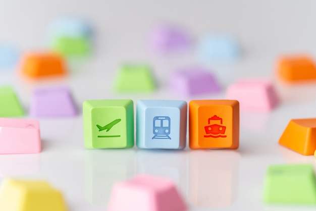 Colorful travel icon on computer keyboard for online booking concept Premium Photo