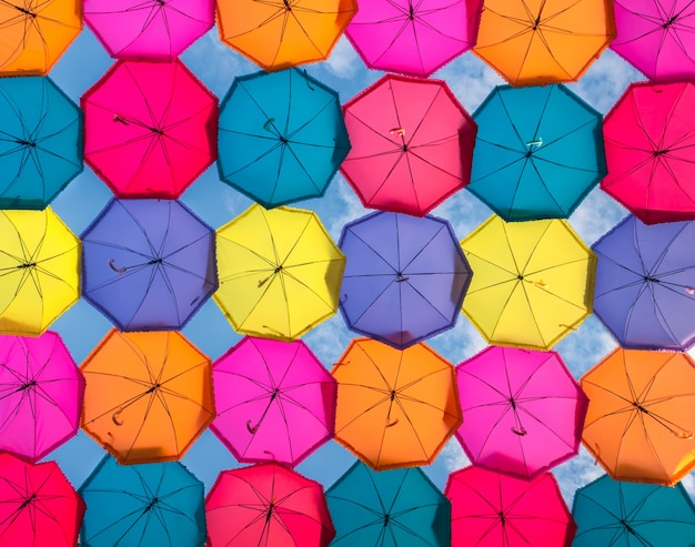 Colorful umbrellas in the sky. street decoration in the city, background Premium Photo