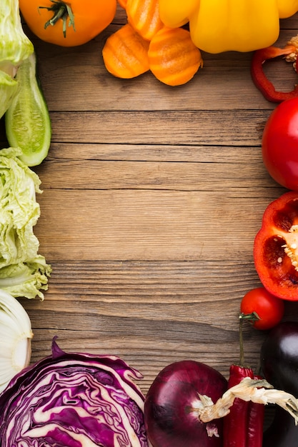 Colorful vegetables assortment on wooden background with copy space Free Photo