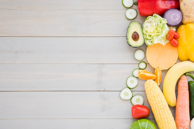 Colorful vegetables on wooden desk backdrop Free Photo