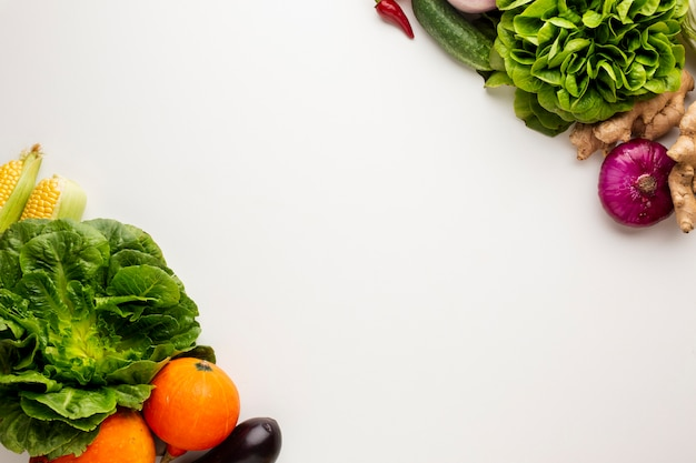 Colorful veggies on white background with copy space Free Photo