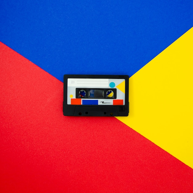 Colorful vintage cassette tape on multicolored background Free Photo
