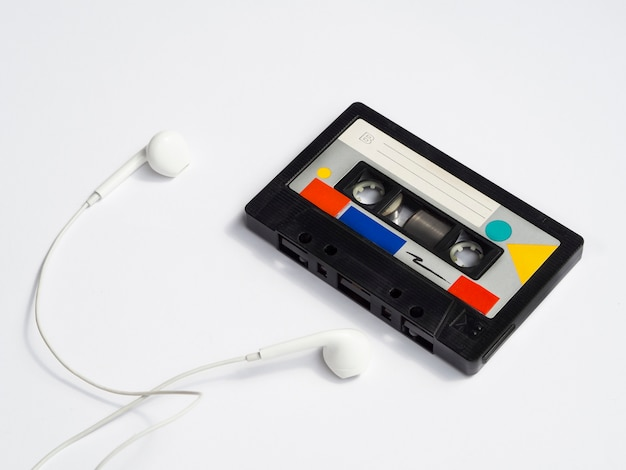 Colorful vintage cassette tape with headphones Free Photo