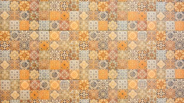 Colorful vintage ceramic tiles wall Premium Photo