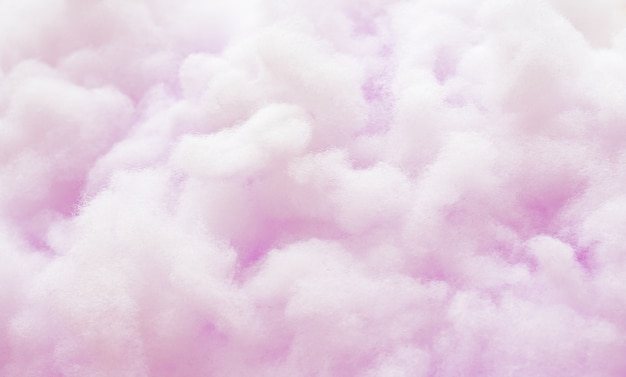 Colorful violet fluffy cotton candy background, soft color sweet candyfloss Premium Photo
