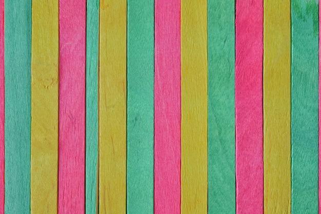Colorful of wood ice cream stick for background design Premium Photo