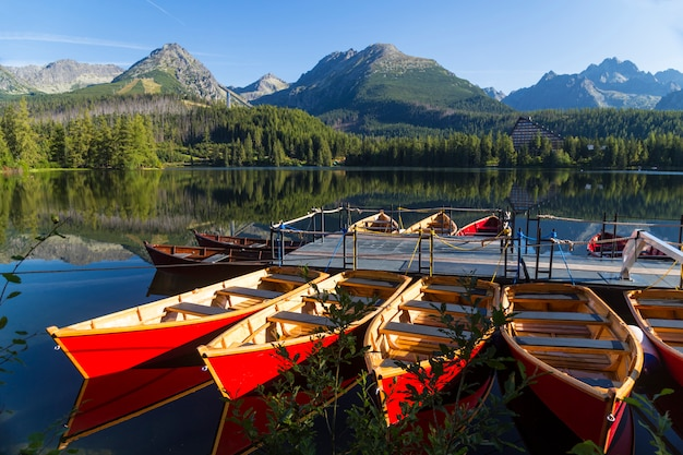 Colorful wooden boat on the mountain lake. Premium Photo