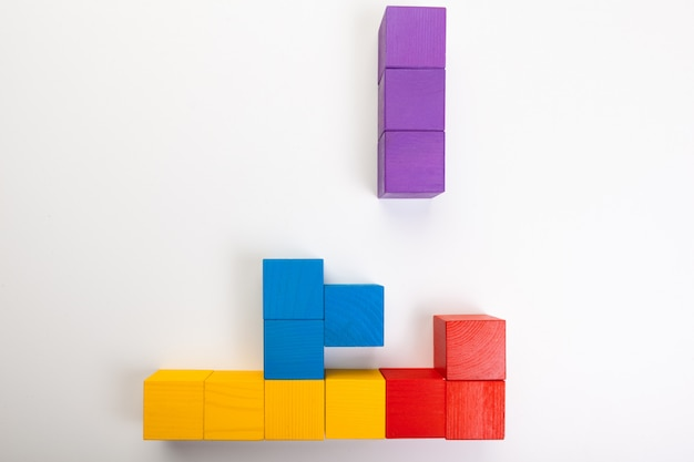Colorful wooden building blocks isolated on white background Premium Photo