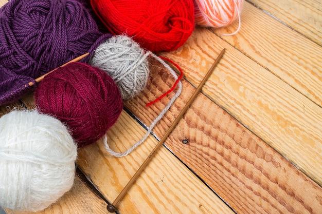 Colorful yarn balls on wood Premium Photo