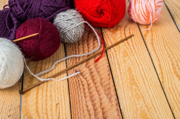 Colorful yarn balls on a wooden table Premium Photo