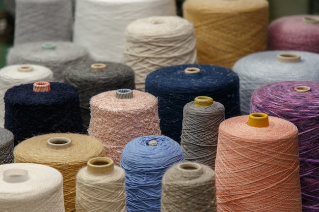 Colorful yarn on spool at the knitting factory. Premium Photo