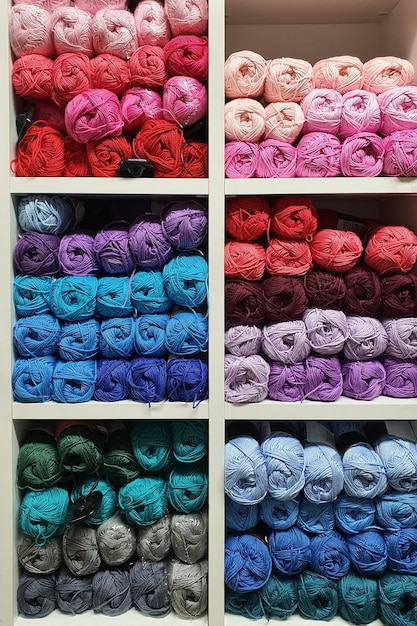 Colorful yarns of wool for knitting on shelves in the haberdashery shop. knitwork handkraft concept Premium Photo