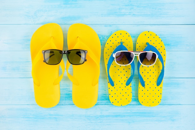 d118ced6f026 Colorful yellow flip flops with sunglasses for summer beach holidays Premium  Photo