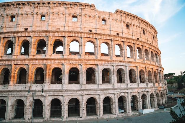 Colosseum or coliseum blue sky in rome Premium Photo