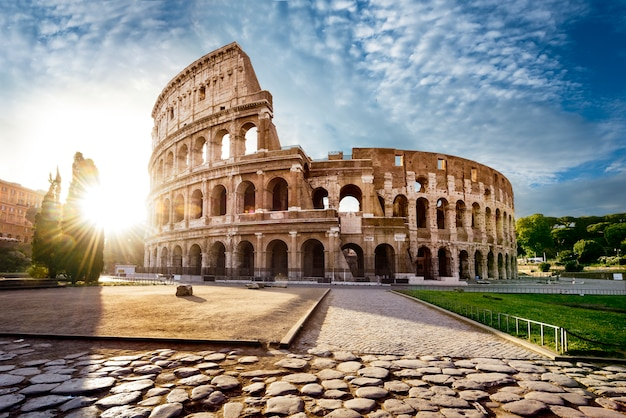 Colosseum in rome and morning sun, italy Premium Photo