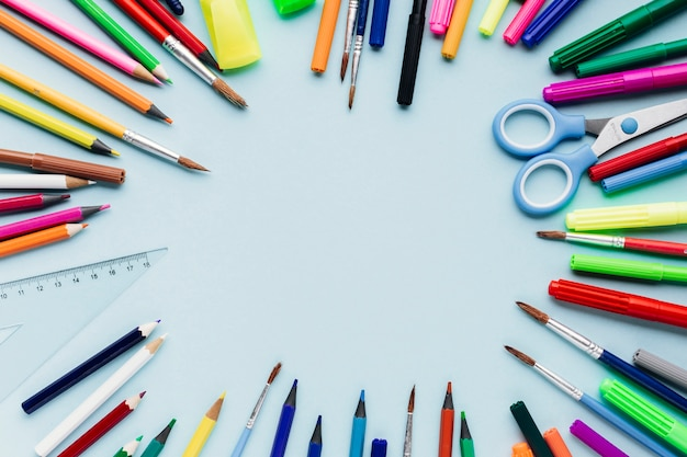 Colour pencils and paintbrushes shaped as frame Free Photo