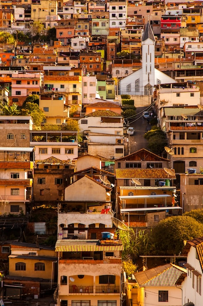 Coloured houses and church in a sloping city in minas gerais - brazil Premium Photo