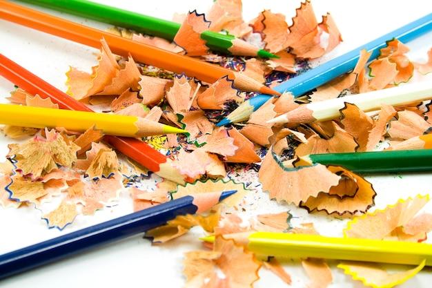 Coloured pencils and sawdust close-up Premium Photo