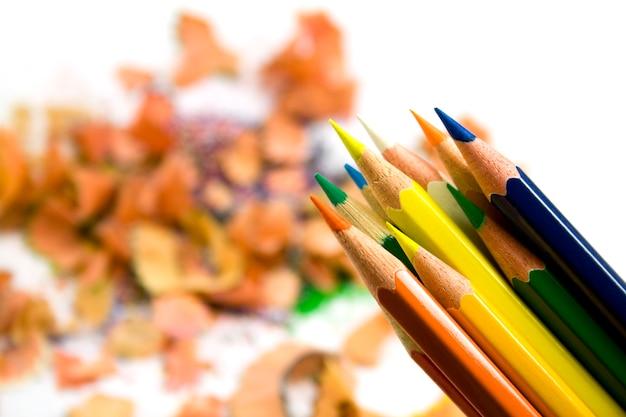 Coloured pensils over sawdust background Premium Photo