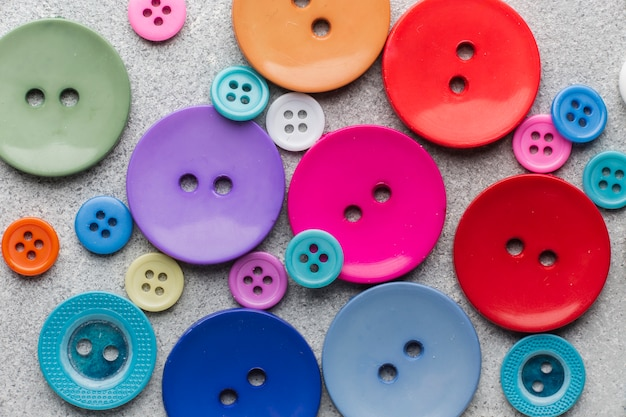 Coloured sewing buttons composition close-up Free Photo