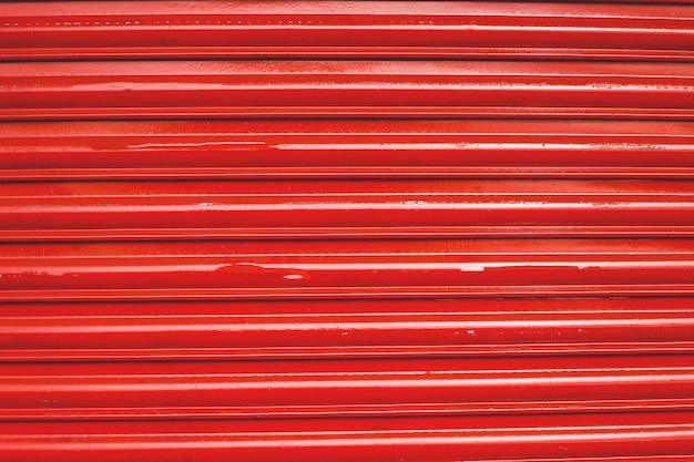 Цветной оловянный забор выложен фон. металлическая текстура Premium Фотографии