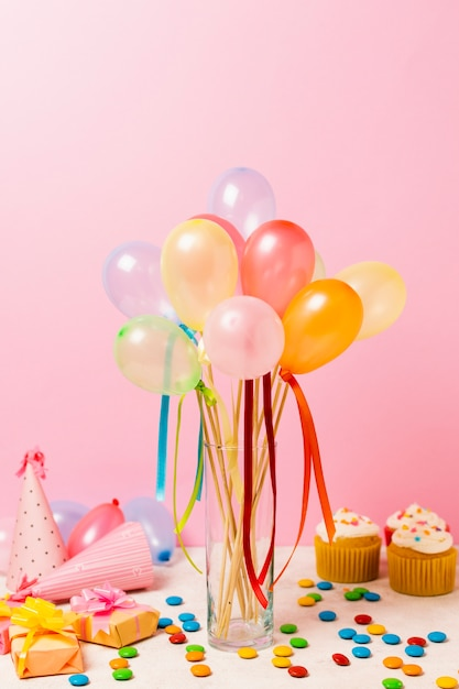 Colourful balloons on table for birthday party Free Photo