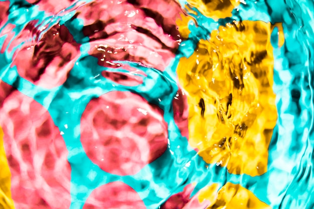 Colourful circle of water waves top view Free Photo