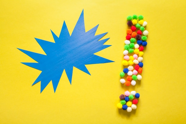 Colourful exclamation point from cotton balls Free Photo