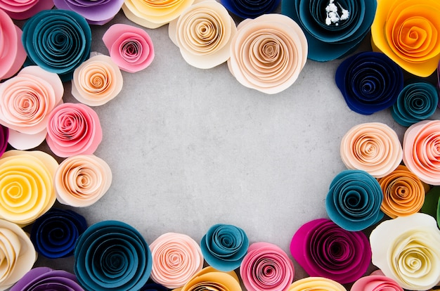 Colourful frame with paper flowers on cement background Free Photo