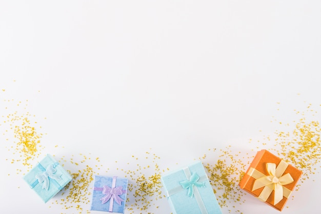 Colourful gifts on white background Free Photo