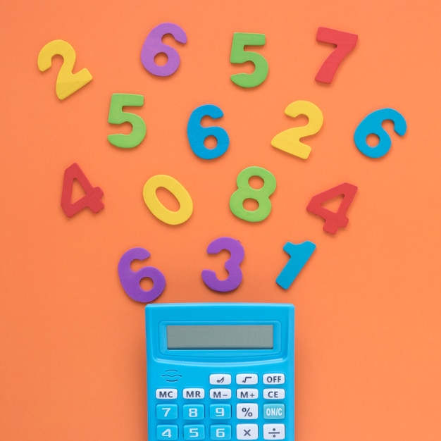 Colourful math numbers with calculator close-up Free Photo