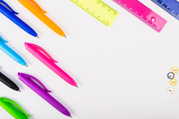 Colourful pens and rulers lie diagonally Free Photo