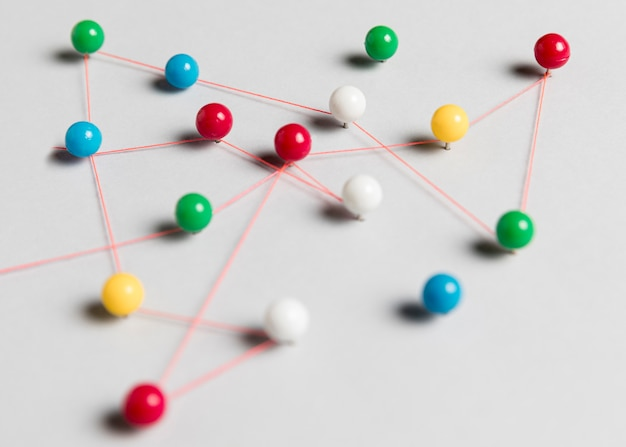 Colourful pins and thread map Free Photo