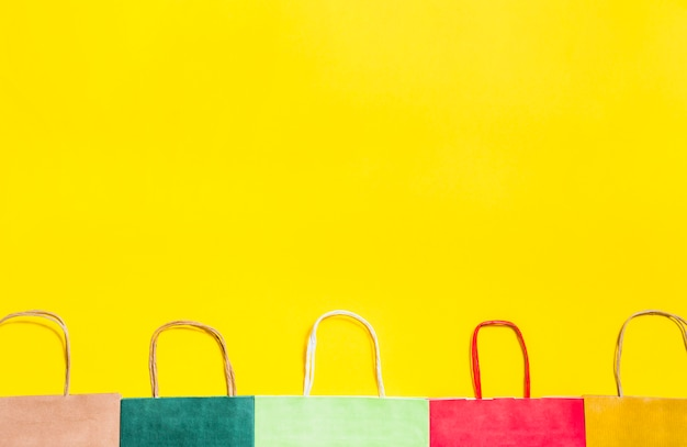 Colourful shopping bags with handles Free Photo