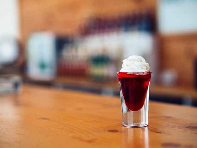 Colourful shot with red drink Free Photo